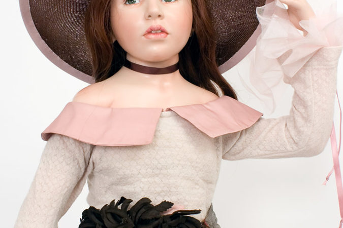 Mid length photo of Justine wax over porcelain art doll by Hildegard Gunzel.