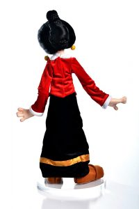 Photo of Olive Oyl doll from behind.