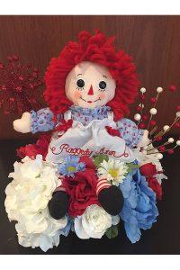 Photo of Raggedy Ann Doll Decor arrangement by Emily Rehm.