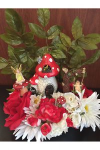 Photo of fairy arrangement with flowers and foliage.