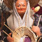 Photo of French santon figure of woman basket weaver.