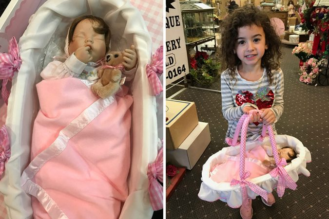 Photo of Baby New Year 2019 doll Sweet Pea and contest winner Maggie McGuire.