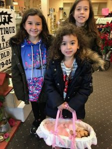 Photo of Dear Little Dollies' Baby New Year Doll contest winner with doll.