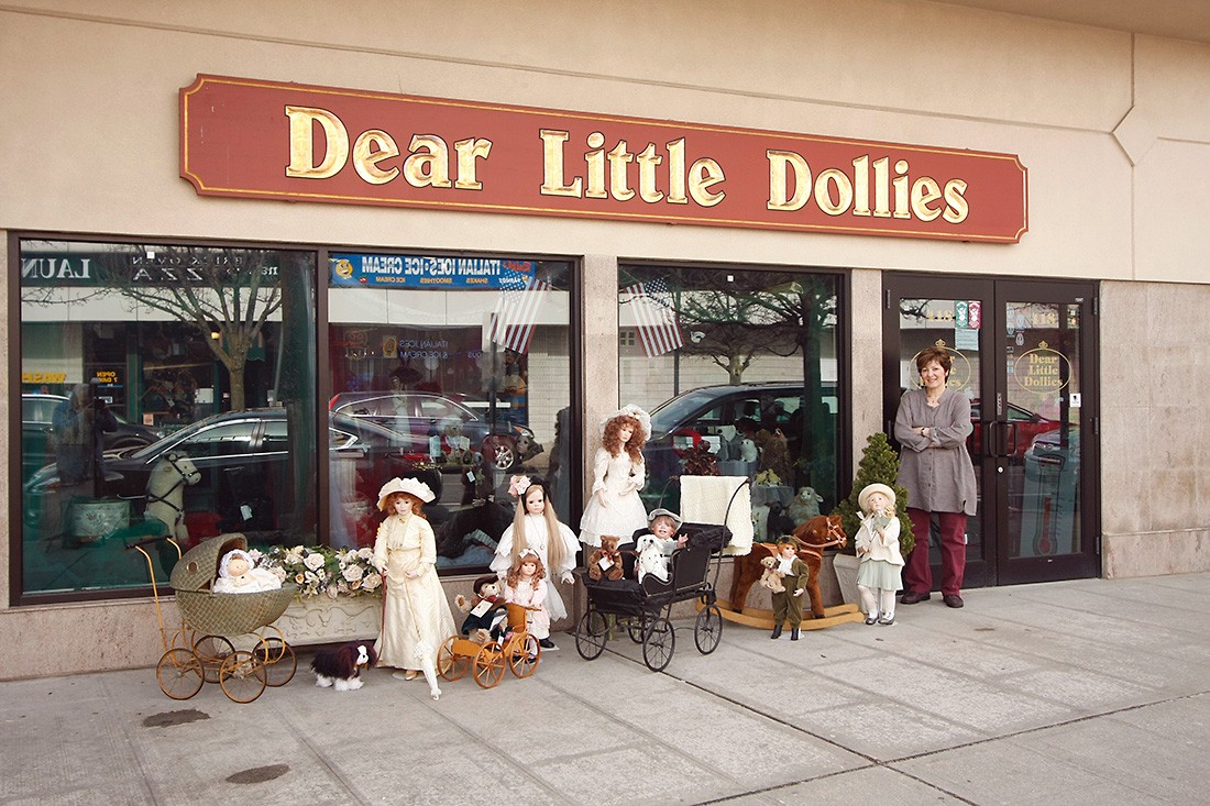 Image of Dear Little Dollies Ltd. storefront with MJ and dolls