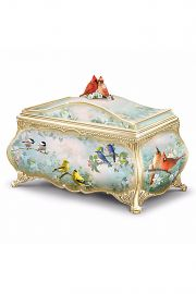Photographic image of Joe Hautman Songbird Serenade porcelain music box by doll artist Joe Hautman for Bradford Exchange.
