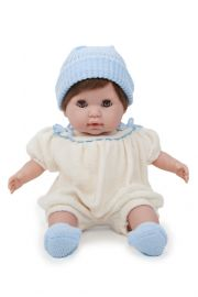 Photo of Nonis doll in cream and blue outfit.