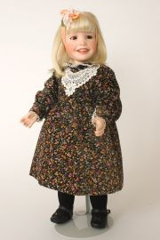 Chloe - collectible limited edition porcelain soft body art doll by doll artist Yolanda Bello.