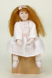 Child Sitting - collectible one of a kind polymer clay miniature doll by doll artist Ronna Morse.