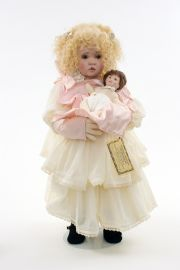 Georgia - collectible limited edition shellcloth art doll by doll artist Linda Murray.