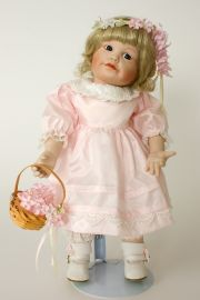 Suzanne the Flower Girl - limited edition porcelain soft body collectible doll  by doll artist Yolanda Bello.