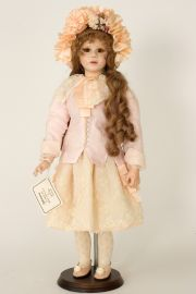 Julieanna - collectible limited edition porcelain wax over art doll by doll artist Janet Ness.