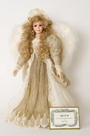 Auroria - collectible one of a kind porcelain wax over art doll by doll artist Janet Ness.