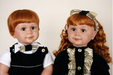 Christmas Boy and Girl - collectible limited edition vinyl play doll by doll artist Johanna Zook.