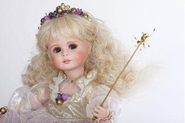 Sugar Plum Cherub - limited edition porcelain collectible doll  by doll artist Connie Walser Derek.