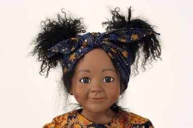 Breezy - collectible limited edition porcelain soft body art doll by doll artist Julia Rueger.