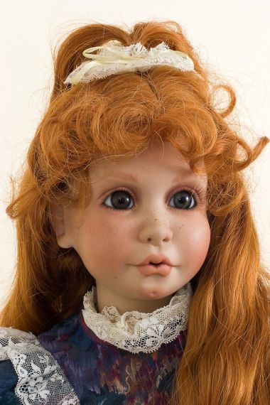 Sydney - collectible limited edition porcelain soft body art doll by doll artist Peggy Dey.