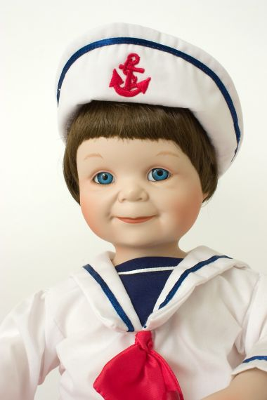 Justin - limited edition porcelain soft body collectible doll  by doll artist Yolanda Bello.