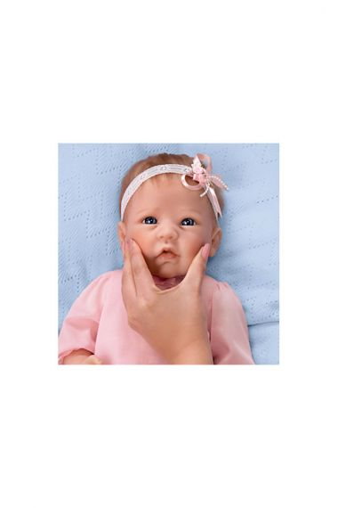 Photographic image of Claire silicone baby doll by doll artist Linda Murray for Ashton-Drake.