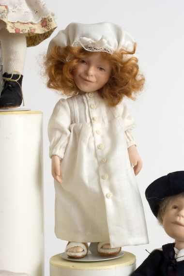 Button Box Kid Penny - limited edition porcelain collectible doll  by doll artist Hal Payne.