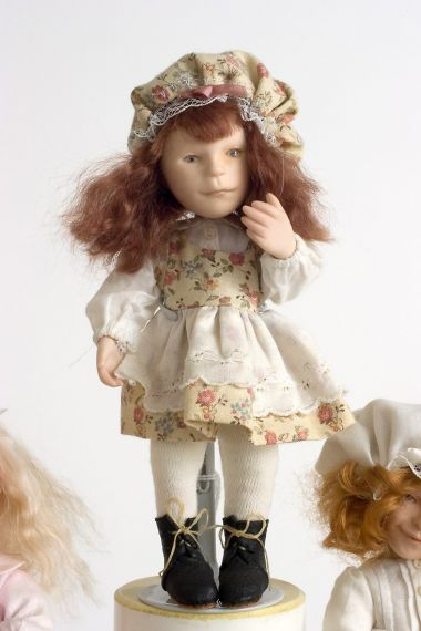 Button Box Kid Louise - limited edition porcelain collectible doll  by doll artist Hal Payne.