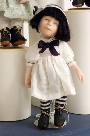 Button Box Kid Sissy - limited edition porcelain collectible doll  by doll artist Hal Payne.